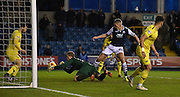 Benjamin Buchel scrambles to stop the goalbound shot during the Johnstone's Paint Trophy semi final first leg match between Millwall and Oxford United at The Den, London, England on 14 January 2016. Photo by Michael Hulf.