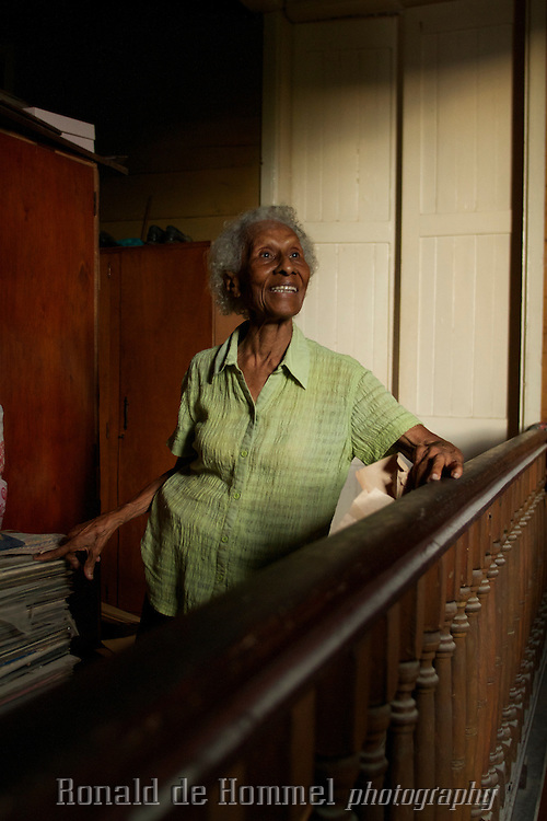 Viviane Gaulthier is a 92 year old dancer still running her own dance studio in her elegant Gingerbread house..At the turn of the 19th century, Port au Prince witnessed a blossoming of ornate architecture - taking a bit of style from New Orleans and some inspiration from Europe, Gingerbread houses started to be built by the city's nobility. The ceilings are high, the wooden doors are curved at the top - Gingerbread architecture makes for cool elegant homes in Haiti's stifling climate..These houses are made mostly of wood with a small amount of brick, and they've proved surprisingly resistant to the shocks of January 12th's earthquake.