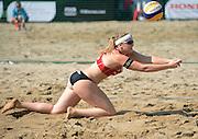 STARE JABLONKI POLAND - July 3:  Katharina Schutzenhofer of Austria in action during Day 3 of the FIVB Beach Volleyball World Championships on July 3, 2013 in Stare Jablonki Poland.  (Photo by Piotr Hawalej)