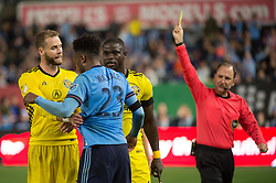 November 5, 2017 - Bronx, New York, U.S - New York City FC defender RODNEY WALLACE (23) is given a yellow card and is confronted by Columbus Crew defender JOSH WILLIAMS (3) and Columbus Crew defender JONATHAN MENSAH (4) for the foul during leg 2 of the Eastern Conference Semifinal at Yankee Stadium, Bronx, NY.  NYCFC defeats Columbus Crew 2-0.  Columbus wins 4-3 on aggregate. (Credit Image: © Mark Smith via ZUMA Wire)