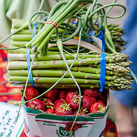 Strawberries, asparagus and garlic scapes, some of the earliest produce available at the farmers market.