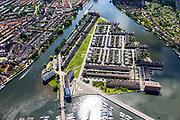 Nederland, Noord-Holland, Zaandam, 14-06-2012; Zaaneiland, gelegen in de monding van rivier de Zaan, tussen Voorzaan en de Oude Haven. Vroeger ingebruik bij de houtindustrie, o.a. houtwerven. Nieuwe woonwijk op eiland, waterstad. <br /> New residential area on former industrial area on island on the river Zaan in Zaandam. <br /> luchtfoto (toeslag), aerial photo (additional fee required)<br /> foto/photo Siebe Swart