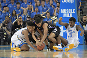 Nov 15, 2017; Los Angeles, CA, USA; UCLA Bruins guard Jaylen Hands (4) and guard Kris Wilkes (13) battle for the ball with Central Arkansas Bears guard Deandre Jones (55) and guard Darraja Parnell (12) during a NCAA basketball at Pauley Pavilion.