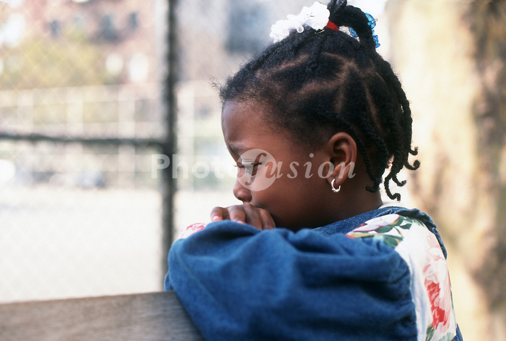 Small girl looking pensive or upset