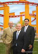 Environmental portrait of executives at an amusement park.