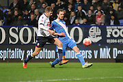 Jack Midson crosses during the The FA Cup Third Round Replay match between Bolton Wanderers and Eastleigh at the Macron Stadium, Bolton, England on 19 January 2016. Photo by Pete Burns.