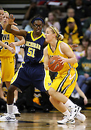 26 JANUARY 2009: Iowa guard Kamille Wahlin (2) passes the ball while being defended by Michigan forward Melinda Queen (51) during the second half of an NCAA women's college basketball game Monday, Jan. 26, 2009, at Carver-Hawkeye Arena in Iowa City, Iowa. Iowa defeated Michigan 77-69.