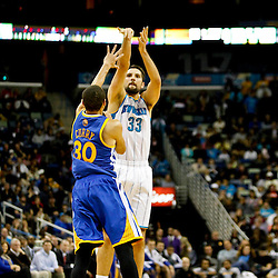 Jan 19, 2013; New Orleans, LA, USA; New Orleans Hornets power forward Ryan Anderson (33) shoots over Golden State Warriors point guard Stephen Curry (30) during  the second quarter of a game at the New Orleans Arena. Mandatory Credit: Derick E. Hingle-USA TODAY Sports