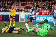 Megan Walsh (GK) (Brighton & Hove) saves the ball after Leonie Maier (Arsenal) attempt at goal during the FA Women's Super League match between Brighton and Hove Albion Women and Arsenal Women FC at The People's Pension Stadium, Crawley, England on 12 January 2020.
