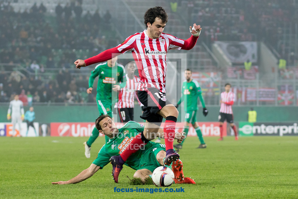 Thomas Schrammel of Rapid Vienna and Inigo Lekue of Athletic Bilbao during the UEFA Europa League match at Allianz Stadion, Vienna<br /> Picture by EXPA Pictures/Focus Images Ltd 07814482222<br /> 08/12/2016<br /> *** UK &amp; IRELAND ONLY ***<br /> <br /> EXPA-PUC-161208-0150.jpg