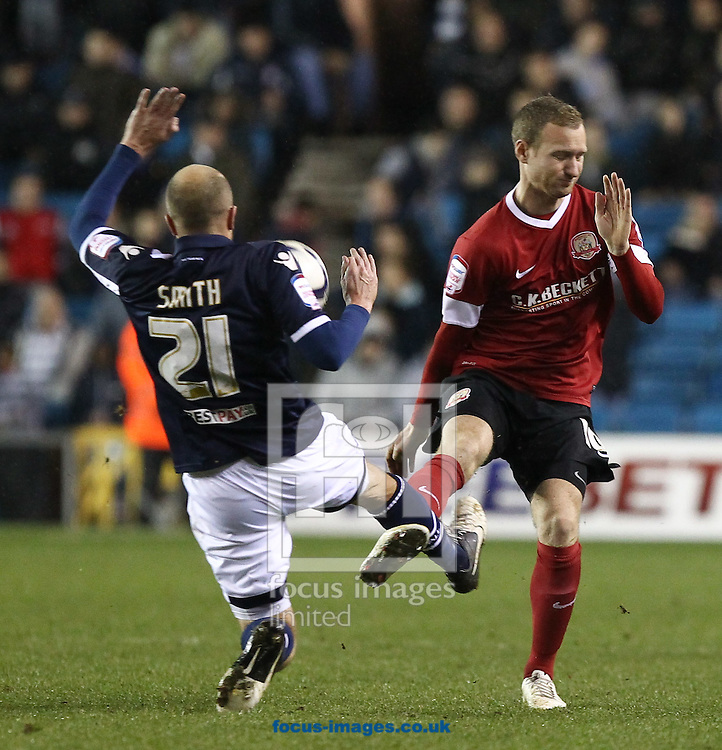 Picture by John  Rainford/Focus Images Ltd +44 7506 538356.22/12/2012.Jack Smith of Millwall and Matty Done of Barnsley during the npower Championship match at The Den, London.