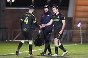 Forest Green Rovers Defender Lee Collins (5) comes off with an injury with Forest Green Rovers Midfielder Lloyd James (4) replacing him during the EFL Sky Bet League 2 match between Colchester United and Forest Green Rovers at the JobServe Community Stadium, Colchester, England on 12 March 2019.