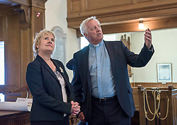 Environment Secretary, Roseanna Cunningham MSP, was in Portobello today to meet the Action Porty community right-to-buy group to mark the Scottish Government giving consent to proceed with the first community right to buy in an urban area. Pictured: Roseanna Cunningham MSP, Rev Dr George Whyte, Church Commissioners<br /> <br /> <br /> © Jon Davey/ EEm