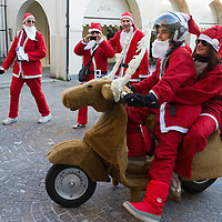 NOALE, ITALY - DECEMBER 18:  Participants dressed as Father Christmas and riding a reindeer Vespa take part in the Noale Santa Run on December 18, 2011 in Noale, Italy. Close to two thousand people participated in the third annual Noale Santa Run, one of the largest non competitive Santa Run in Italy.