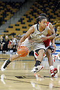 January 27, 2011: Central Florida guard Geneva Carter (5) is fouled by Houston guard Porsche Landry (20) on a drive to the basket during first half womens Conference USA NCAA basketball game action between the Houston Cougars and the Central Florida Knights at the UCF Arena Orlando, Fl.