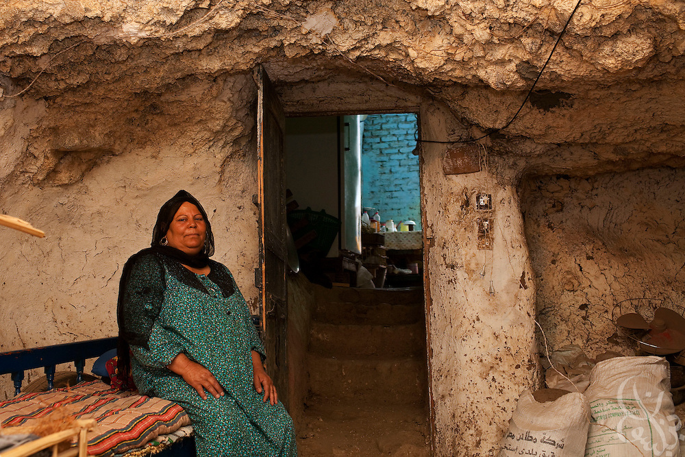 Raya Mohammed (60) sits with her grandson inside an ancient tomb that her house is built over June 6, 2009 in the village of Gourna on the West bank of the Nile river near Luxor. Mohammed and several other families of the village are among the last to hold out from Egyptian authorities plans to forcibly resettle all the residents of this area as part of a 30 year, 5 billion egyptian pound redevelopment plan. (Photo by Scott Nelson, for the Times)