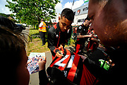 AFC Bournemouth forward Joshua King signing autograph on a team shirt for a fan as he arrives for the Premier League match between Bournemouth and Burnley at the Vitality Stadium, Bournemouth, England on 13 May 2017. Photo by Graham Hunt.