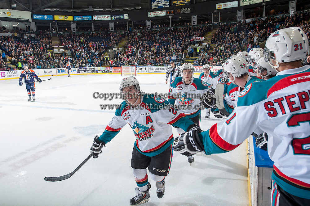 KELOWNA, CANADA - MARCH 14: Tyson Baillie #24 and Gage Quinney #20 of Kelowna Rockets celebrate a goal against the Kamloops Blazers on March 14, 2015 at Prospera Place in Kelowna, British Columbia, Canada.  (Photo by Marissa Baecker/Shoot the Breeze)  *** Local Caption *** Tyson Baillie; Gage Quinney;