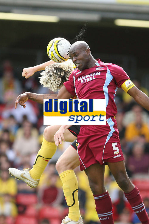 Photo: Pete Lorence/Richard Lane Photography. <br />Watford v Scunthorpe United. Coca-Cola Championship. 26/04/2008. <br />Izzy Iriekpen clears the ball from Darius Henderson.