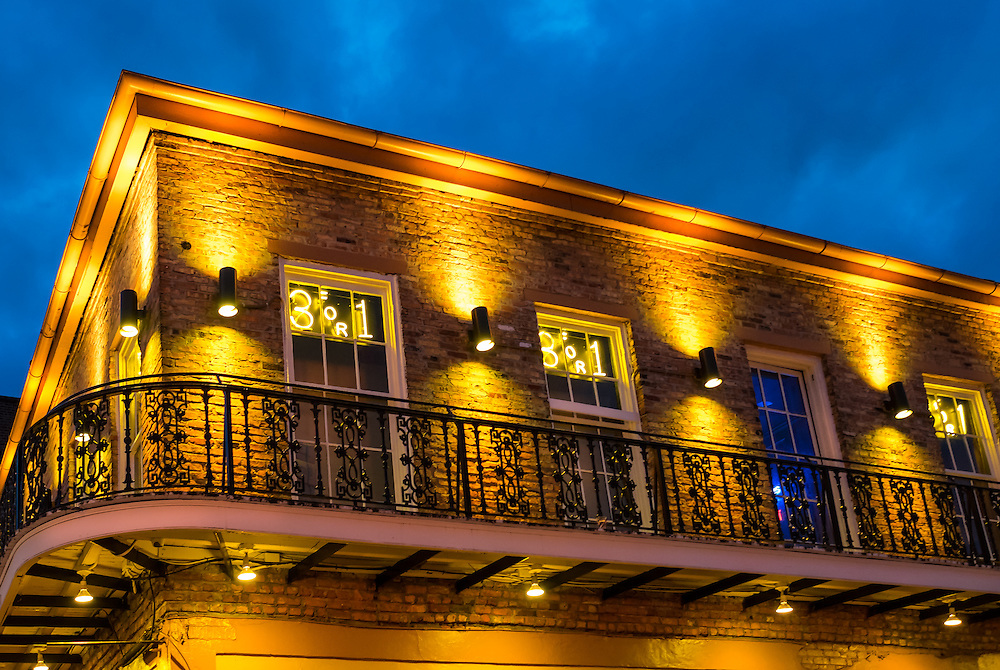 NEW ORLEANS - CIRCA FEBRUARY 2014: View of a typical facade and balcony over Bourbon Street in the New Orleans French Quarter in Louisiana, at night.