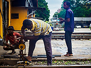 07 OCTOBER 2017 - COLOMBO, SRI LANKA: Workers remove rails during a repair at the Fort Station in Colombo. The Fort Station is Colombo's main train station and serves as the hub of Sri Lanka's train system. The station opened in 1917 and is modeled after Manchester Victoria Station.    PHOTO BY JACK KURTZ