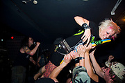 Crowd surfing audience at Municipal Waste gig, at Louvre. Prague, Czech Republic. 21 & 22/05/07
