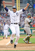 DETROIT, MI - OCTOBER 07: Omar Infante #4 of the Detroit Tigers celebrates as he scores the game-winning run on a sacrifice fly hit by Don Kelly #32 in the bottom of the ninth inning against the Oakland Athletics during Game Two of the American League Division Series at Comerica Park on October 7, 2012 in Detroit, Michigan. (Photo by Jason Miller/Getty Images)
