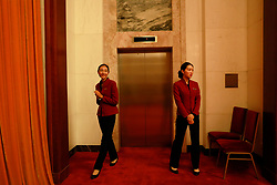 epa06270825 Chinese hostesses stand by a lift in the Great Hall of the People (GHOP) where the 19th National Congress of the Communist Party of China (CPC) will be held in Beijing, China, 17 October 2017. The five-yearly 19th National Congress of the Communist Party of China (CPC) will begin on 18 October.  EPA-EFE/HOW HWEE YOUNG