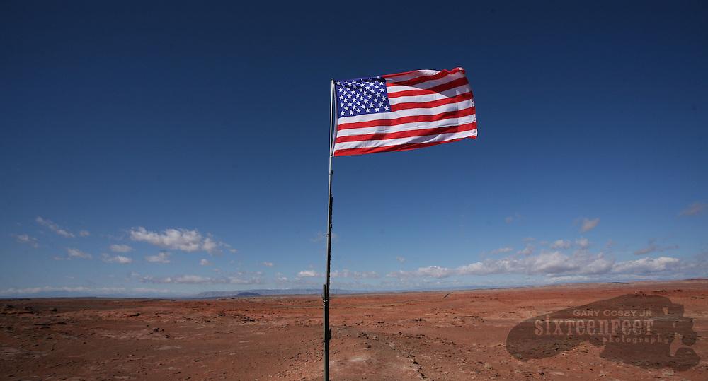 Photo by Gary Cosby Jr.  An American flag flies In Navajo lands near Tuba City, AZ.