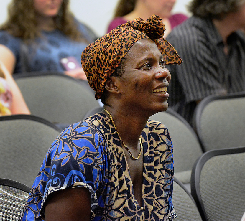 jt072817i/ a sec/jim thompson/   Kaluta(no last name)from Congo, is a parent of one of the students that went through the refugee summer school program at Highland High School looks on as students give a slide show at talk about being in the summer program.   Friday, July. 28, 2017. (Jim Thompson/Albuquerque Journal)