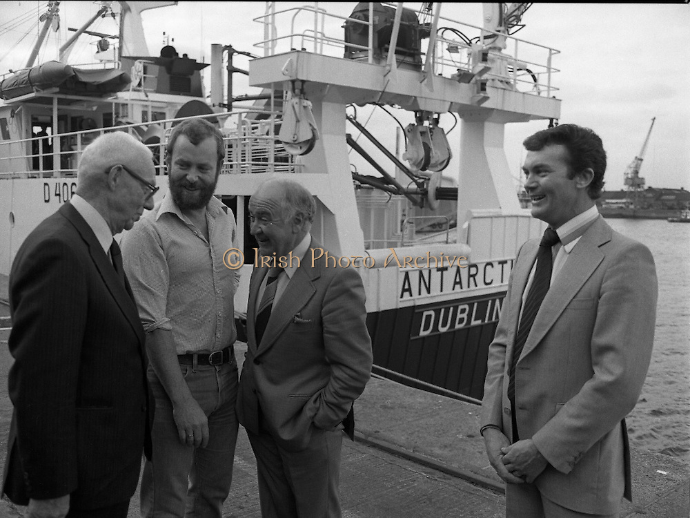 """Super Trawler """"Antarctic"""".    (N44)..1980..02.10.1980..10.02.1980..2nd October 1980..The first of five super-trawlers for Ireland, The Antarctic, for Kevin McHugh,an Achaill Islander,arrived in Dublin today.The vessel whch cost over £2million marks the beginning of a middle water fleet for Ireland..Image shows Michael McHugh, Chairman, Irish Fish Producers Organisation,Mr Brendan O'Kelly, Chairman, Bórd Iascaigh Mhara and the skipper of 'Antarctic' Kevin McHugh..Unfortunately we do not have the name of the bearded gentleman if you know him why not contact us at irishphotoarchive@gmail.com"""