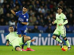 Aleksandar Kolarov of Manchester City (L) tackles Riyad Mahrez of Leicester City  - Mandatory byline: Jack Phillips/JMP - 07966386802 - 29/12/2015 - SPORT - FOOTBALL - Leicester - King Power Stadium - Leicester City v Manchester City - Barclays Premier League