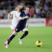 United States midfielder Rose Lavelle (16) runs past England midfielder Keira Walsh (4) during the first match of the 2020 She Believes Cup soccer tournament at Exploria Stadium on 5 March 2020 in Orlando, Florida USA.
