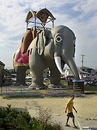An unidentified boy walks past Lucy the Margate Elephant, Saturday, Aug. 17, 2002, in Margate, New Jersey. Lucy, a sixty-five-foot high, wooden elephant, which was built in 1881, was declared a national historic landmark in 1976. (Photo by William Thomas Cain/photodx.com)