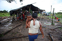 A Nukak-Maku Indian baby is carried home after having a bath at a camp just outside of San Jose de Guaviare on November 20, 2006. The Indians at the camp are now part of Colombia?s displaced community. With limited exposure to the western world they have left behind their nomadic traditions in the Colombian jungle in a large part due to fear of the FARC, the leftist rebels who control much of the jungle that was traditionally inhabited by the Indians and that is now being used by the FARC to produce cocaine which finances their war.(Photo/Scott Dalton)