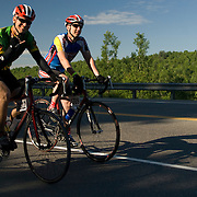 Two male Trekkers ride along a road in the early morning near Farmington, ME. The 2007 Trek Across Maine, an annual project of the American Lung Association of Maine (ALAM).