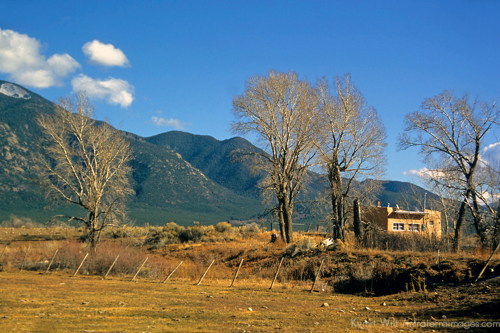 USA, New Mexico, Taos County.  Scenic mountains and Wheeler Peak provide the backdrop for Taos Pueblo land.