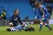 Brighton & Hove Albion defender Gaetan Bong (12) is down injured during the Sky Bet Championship match between Brighton and Hove Albion and Preston North End at the American Express Community Stadium, Brighton and Hove, England on 24 October 2015. Photo by Phil Duncan.