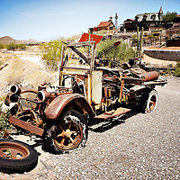Decaying old car in the desert in USA