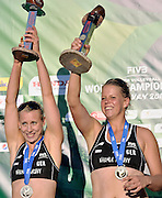 Silver medalists Karla Borger (L) and Britta Buthe (R) from Germany while medal ceremony during Day 6 of the FIVB World Championships on July 6, 2013 in Stare Jablonki, Poland.