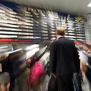 May 24, 2016 - New York, NY :  Commuters traverse the Amtrak Concourse on Penn Station's upper level during the evening rush on Tuesday. Above them, music filters into the space through a series of in-ceiling speakers (not visible). CREDIT: Karsten Moran for The New York Times **MOTION BLUR CREATED WITH LONG SHUTTER SPEED AND MOVING CAMERA**