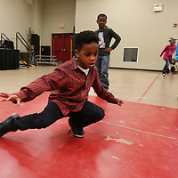 Adam Robison | BUY AT PHOTOS.DJOURNAL.COM<br /> Demarr Taylor, 8, a second grader at Parkway Elementary School, break dances during the freestyle dance time in Mary Frances Massey's dance class Tuesday morning at the school.