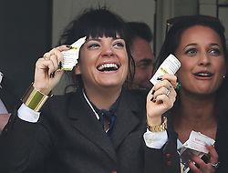 Lily Allen celebrates as the winner of the Cheltenham Gold Cup crosses the line  at the Cheltenham Festival, United Kingdom, Friday, 14th March 2014. Picture by Stephen Lock / i-Images