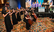 The Johnston Middle School Varsity Mixed Choir and Advanced Orchestra perform during the Houston ISD State of the Schools luncheon at the Hilton of the Americas, February 26, 2014.