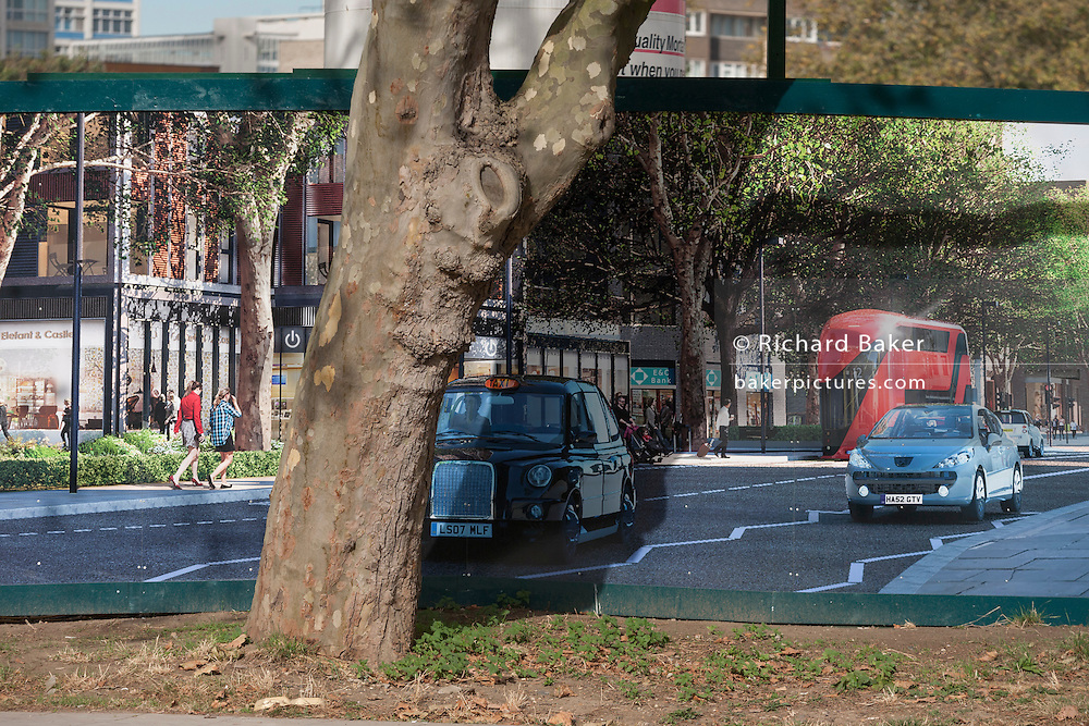 A Plane tree and a regeneration project hoarding at Elephant Park, at Elephant & Castle, London borough of Southwark. Southwark Council's development partner, Lendlease is regenerating over 28 acres across three sites at the heart of Elephant & Castle, in what is the latest major regeneration opportunity in zone 1 London. The vision for the £1.5 billion regeneration is to build on the area's strengths and vibrant character in order to re-establish Elephant & Castle as one of London's most flourishing urban quarters. The Elephant & Castle regeneration is of a scale rarely seen in central London and includes almost 3,000 new homes, plus office, retail, community, leisure and restaurant space.