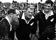 Wilson Whineray lays down the law during the first test of the 1965 series between the All Blacks and the Springboks at Wellington. Next to Whineray are: Bruce McLeod (bending over), Stan Meads, Brian Lochore and Kel Tremain (crouching).<br /> Photosport