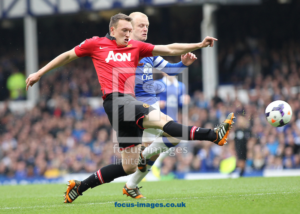 Steven Naismith of Everton and Phil Jones of Manchester United in action during the Barclays Premier League match at Goodison Park, Liverpool.<br /> Picture by Michael Sedgwick/Focus Images Ltd +44 7900 363072<br /> 20/04/2014