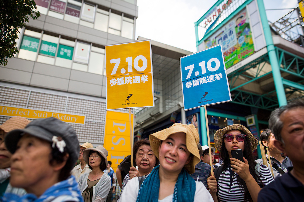 TOKYO, JAPAN - JULY 7 :  Supporters watch Kazuo Shii, Chairman of the of The Japanese Communist Party (JCP) delivers a campaign speech for his party candidate Taku Yamazoe during the Upper House election campaign outside of Kichijōji Station, Tokyo, Japan on July 7, 2016. Japan's upper house election will be held on this coming Sunday July 10, 2016. (Photo by Richard Atrero de Guzman/NURPhoto)