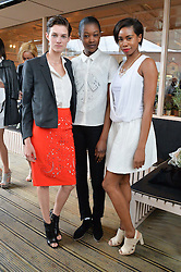 Left to right, HARMONY BOUCHER, BETTY ADEWOLE and TOLULA ADEYEMI at a supper and screening of 'No More Tiaras' a film by Mary Nighy held at Shrimpy's, King's Cross Filling Station, Goods Way, London on 7th May 2014.