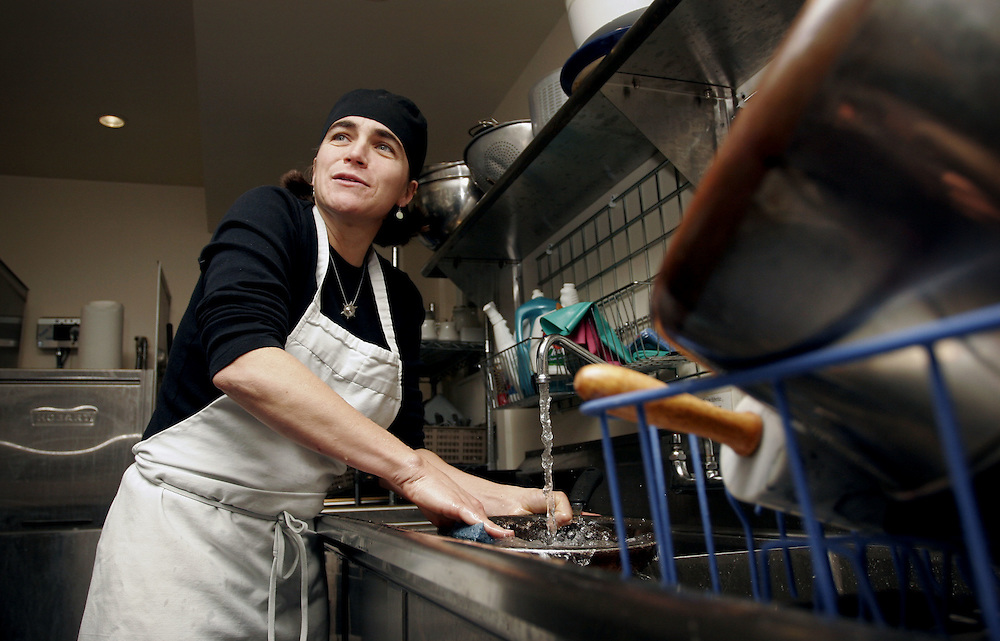 "Cindy Pierce of Etna, N.H., works in the kitchen at Pierce's Inn, a lodge she and her husband run in Etna, N.H., on Nov. 19, 2005. Pierce draws upon her life experiences as for her one-woman show, ""Finding the Doorbell."" (Photo by Geoff Hansen)"